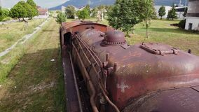 Old train cemetery. Aerial view of an old abandoned rusty steam train.