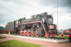Old train decorates the apron. These trains traveled around Russia 100 years ago Royalty Free Stock Photography