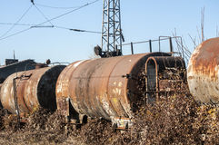 Old train fuel and oil tanks Royalty Free Stock Photography
