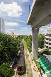 Old train and high railway. In city of Thailand Stock Photo