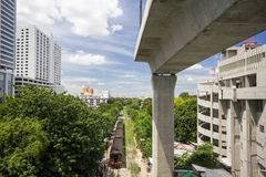 Old train and high railway. In city of Thailand Royalty Free Stock Photography