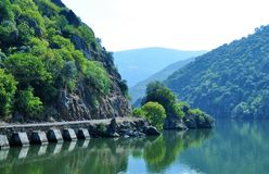 Old train line by the river - Douro river. Photo of the old train line by the river - Douro river - Trás-os-Montes and Alto Douro Province - Portugal royalty free stock photos