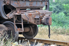 Old train on railway. Part of railway and old train body, shown as old industry concept and a kind of transportation method Royalty Free Stock Images