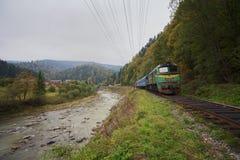 Old train on a railway in a mountainous area. Carpathians Royalty Free Stock Photos