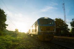 Old Train on Railway Track i. N morning sunshine with Rural Scene Royalty Free Stock Images