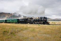 Old Train Runs Through The Plains Stock Photo
