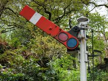 Old Train Semaphore In Forest Stock Image