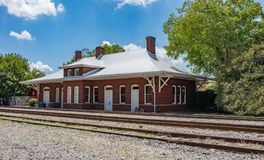 An old train station alongside the railroad tracks. royalty free stock photography