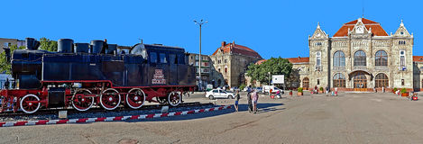 Old train station in Arad, Romania and a steam locomotive ahead Royalty Free Stock Photography