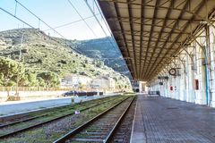 Old train station with a bow or arch. Yellowish color on a sunny day. stock photo