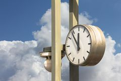 Old train station clock,  a classic watch for information Stock Photos