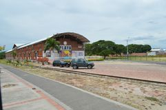 Old train station in Girardot. Surrounded by modern roads and cars Stock Photo