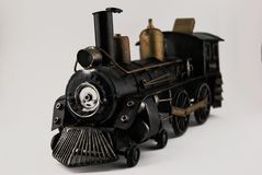 OLD TRAIN TOY. OLD METAL TRAIN TOY, IN A WHITE BACKTGROUND Royalty Free Stock Photo