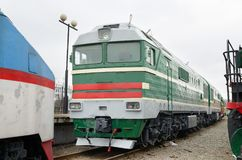Old train on the tracks. It is a historical monument of the railway Stock Photo