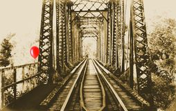Old train truss bridge. Abandoned beam bridge in small town Front Royal Virginia done in sepia tone with one singe red balloon attached to the rail. Creepy Royalty Free Stock Images