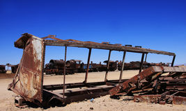 Old train in uyuni salar in bolivia Royalty Free Stock Image