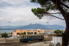 Old train wagon in Arbatax, Sardinia. Italy. Mountains and sky with clouds in the background. Nobody in the scene Stock Photo