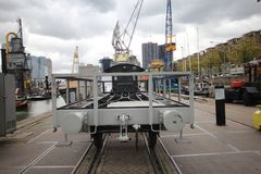 Old train wagon and crane on the  quay in the harbor museum of Rotterdam. Netherlands Royalty Free Stock Photography
