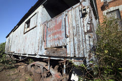 Old train wagon deteriorating at the station Royalty Free Stock Photo