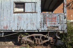 Old train wagon deteriorating at the station Stock Photography