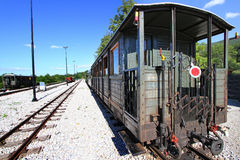 Old train wagon in station Stock Images