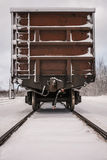 Old train wagon on track in winter Royalty Free Stock Images