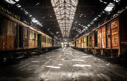 Old trains at abandoned train depot Stock Photos