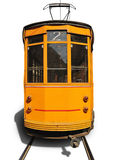 Old tram. Old yellow tram isolated against white background. Milan, Italy Stock Image