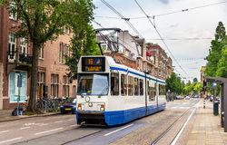 Old tram in Amsterdam. A tram driving in Amsterdam - the Netherlands stock photos