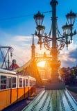 Old tram at bridge freedom sunshine Budapest Royalty Free Stock Image