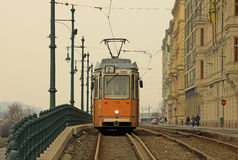 Old tram in Budapest on Pest bank route. February, 2012. Old tram in Budapest, Hungary Royalty Free Stock Images