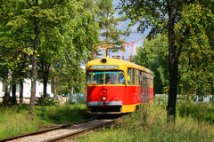 Old tram in bushes. Old red and yellow tram in bushes Royalty Free Stock Image
