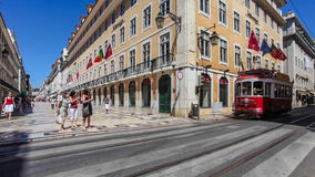 Old tram crosses the Augusta Street in Lisbon Royalty Free Stock Photos