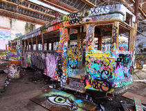 Old tram with grafiti. Art can be expressed in many ways as can be seen on this old unused tram royalty free stock photography