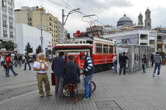 Old tram in Istanbul. Greek Church in Taksim at the top looks. Istanbul, Turkey - September 21, 2012: the former tram on Istiklal Street in Istanbul, Taksim Stock Photo