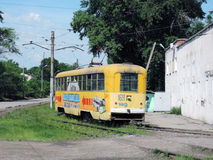 An old tram in Khabarovsk. The old yellow tram in Khabarovsk Stock Photos