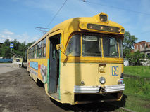 An old tram in Khabarovsk. The old yellow tram on Amur boulevard Royalty Free Stock Photography