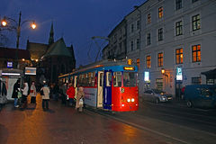 Old tram in Krakow at night, Poland Stock Photos