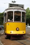 Old tram in Lisbon. In yellow and white in front view stock image