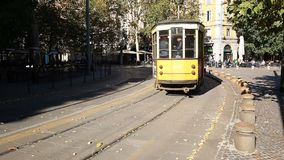 Old tram. MILAN, ITALY - OCTOBER 2017; Old tram, historic public transport, in Sempione Gate area stock video footage