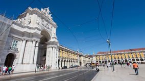 Old tram and a modern bus pass at Praca do Comercio, Lisbon stock footage
