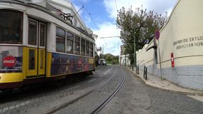 An old tram on the street in Lisbon. An old tram on the narrow streets in the center of Lisbon, Lisbon stock video