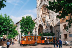 Old tram in Soller in front of medieval gothic cathedral with huge rose window, Mallorca, Spain Royalty Free Stock Image