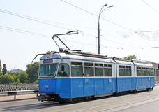 Old tram on a street. Old blue tram on a street Stock Photography