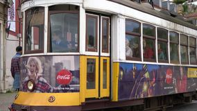 An old tram on the street in Lisbon. The famous tram n.28 on the streets of the center of Lisbon, Portugal stock footage