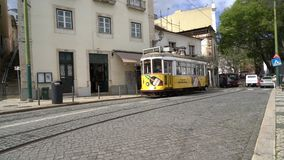 An old tram on the street in Lisbon. The famous tram n.28 on the streets of the center of Lisbon, Portugal stock video