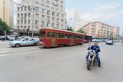 Old tram on the streets of Dalian in China Royalty Free Stock Photography