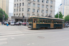 Old tram on the streets of Dalian in China stock photography