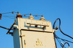 Old transformer against blue sky Stock Photo