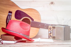 Old transistor radio and Acoustic guitar on wooden background. Royalty Free Stock Photo